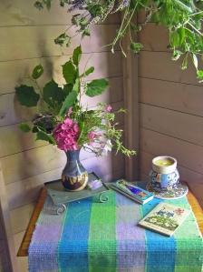 Garden Studio, Table, Flowers & Hanging Herbs