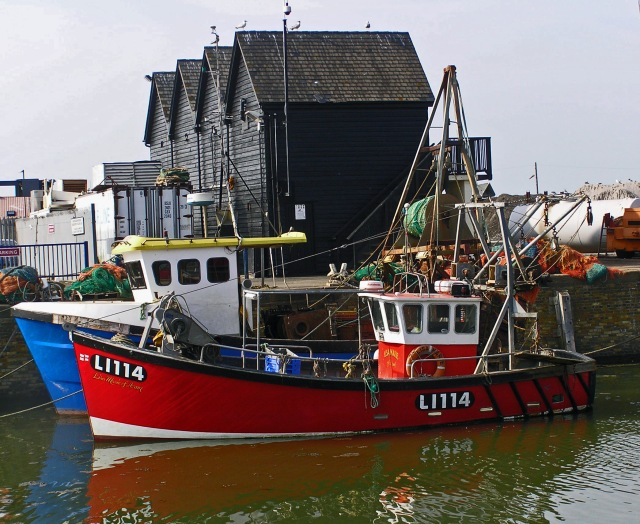 Boat and Black Buildings Whitstable