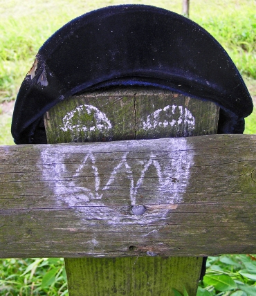 Hat on Post and Chalked Face